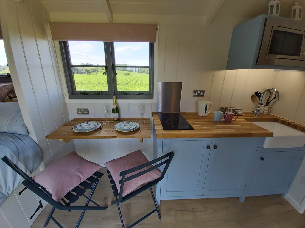 Our shepherds hut in Yorkshire has a mini kitchen and dining area has all you need to rustle up a good meal.